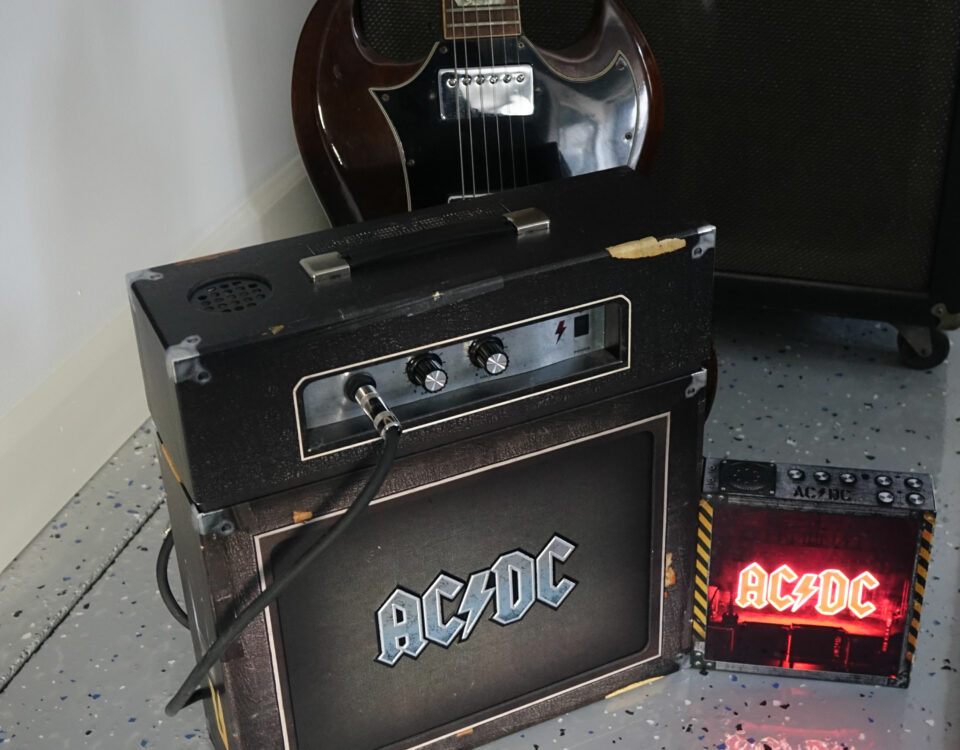 The Power Up lightbox in action next to AC/DC boxset amplifier.